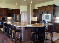 Large gourmet kitchen with plenty of seating around island