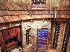Wine room with custom cedar roof theme and rock walls
