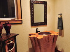 Powder room on main level for guests with stump vanity sink
