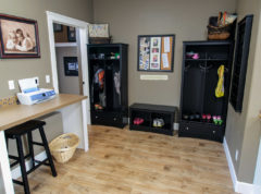 Spacious mud room that shares space with laundry room