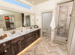 Master Bathroom with Tile floors and accent LED kick panel lighting